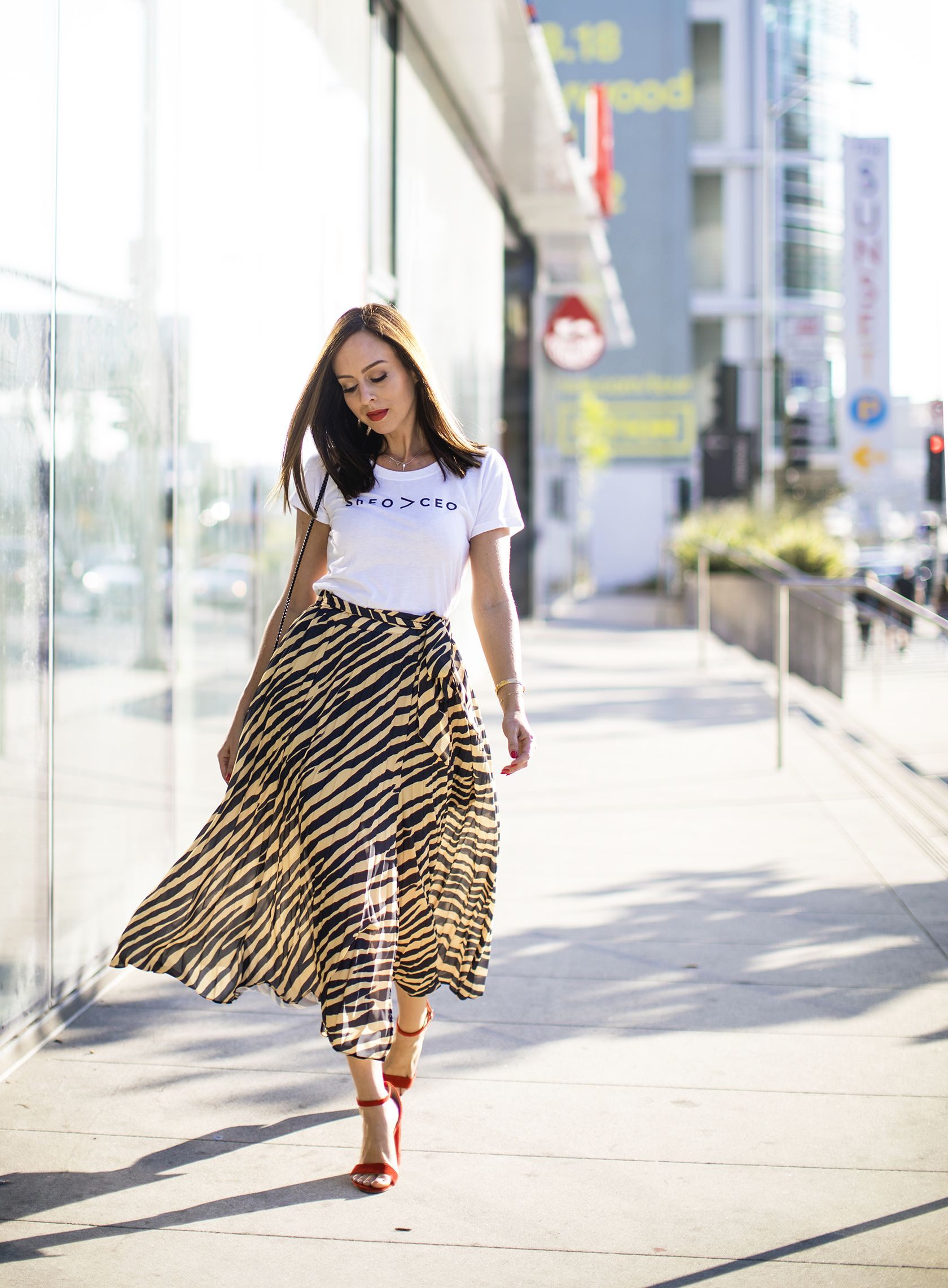 d6a7519ad064 Sydne Style shows how to wear the animal print trend with topshop zebra  print skirt #zebra #skirts #tees #tshirt #graphictee