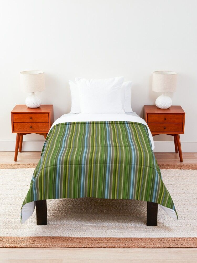 Between Earth and Sky Green and Blue Stripes Comforter Vivid, full color print on front, white on back 100% polyester fabric, 3/4 inch (2cm) polyester filling, and double square quilted pattern Available in multiple sizes from twin to king. Twin XL size fits most extra long college dorm room beds; check sizing guide for detailed measurements Machine washable