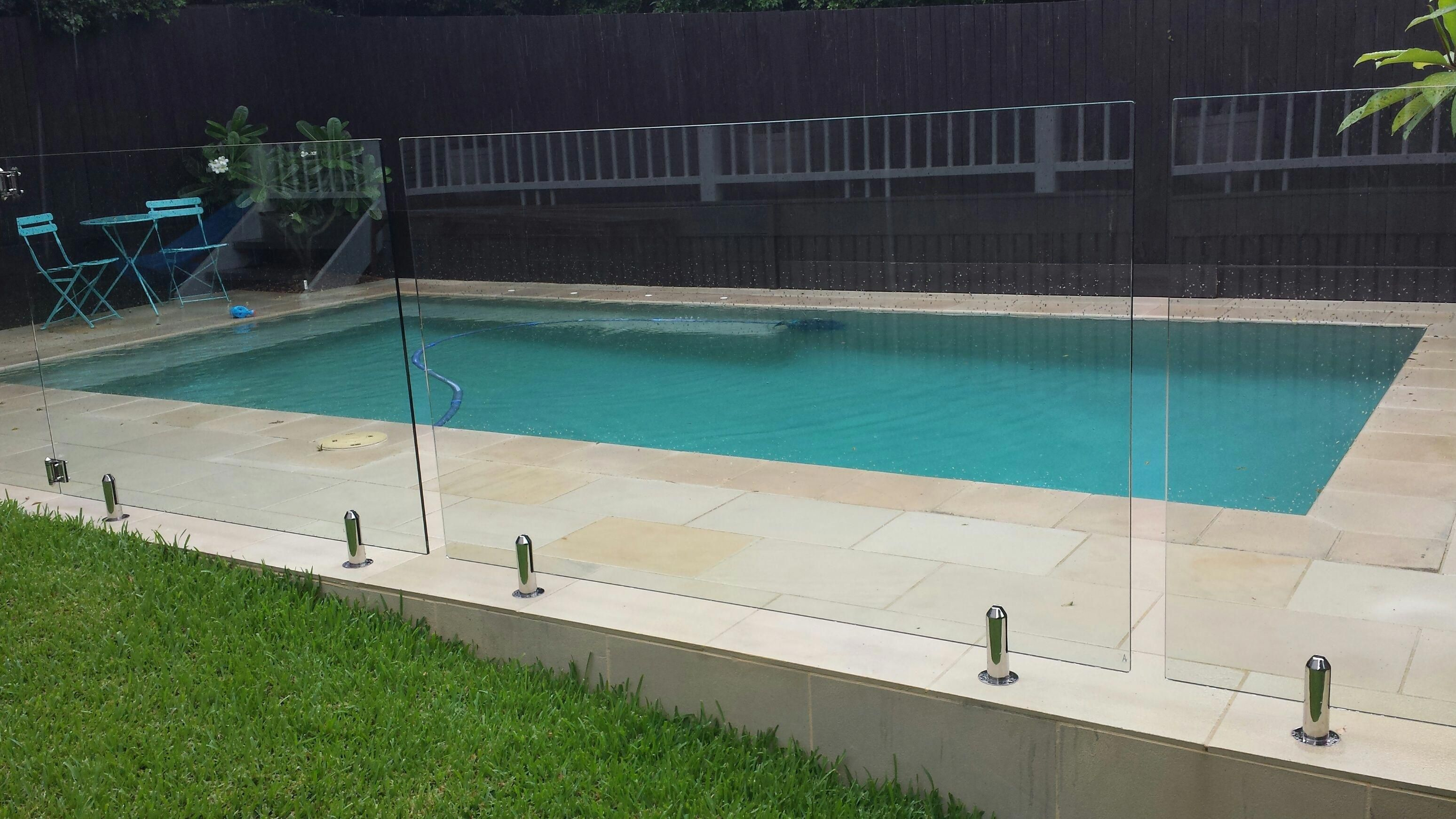 Sawn And Sandblasted Sandstone Paving And Coping Around Pool Glass Pool Fence Ecobuilt Landscaping Brisbane Glass Pool Fencing Pool Paving Pool Landscaping
