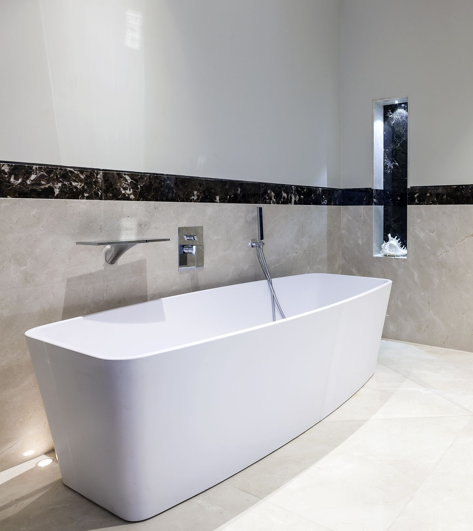 StoneKast Geo free standing bath with Hansgrohe Axor brassware ...