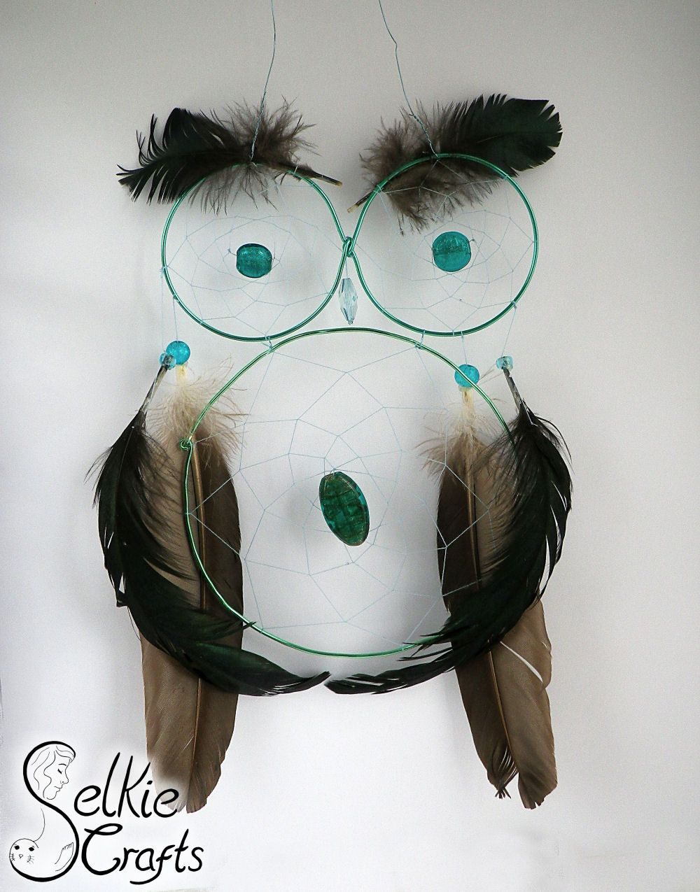 sea green owl dream catcher.