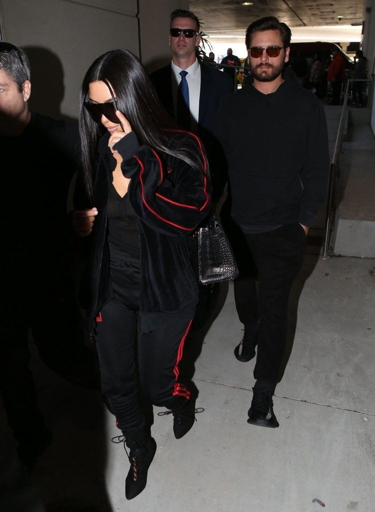 4c48cfff31a4a Scott Disick Rocks John Elliott Hoodie And Yeezy Sneakers With Kim  Kardashian In Pony Jacket And Yeezy Season Pants