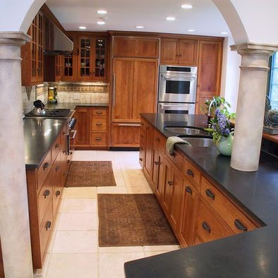 Medium Oak Stain With Slate Counters And Nice Hard Ware Also Glass Front Cabinets Again Mediterranean Kitchen Design Hickory Kitchen Cabinets Oak Kitchen