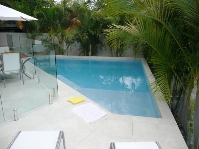 Small inground pools for small yards tranquil pool this for Above ground pool decks brisbane
