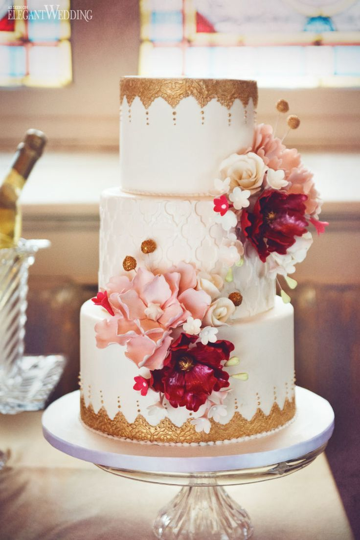 pink and gold wedding cake with sugar flowers www.elegantwedding