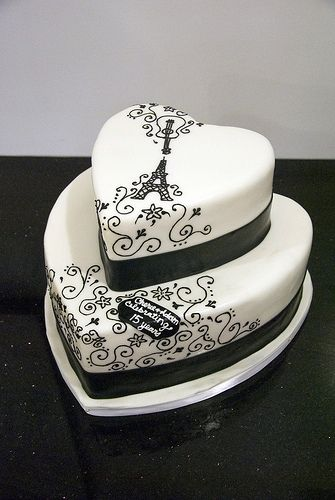 White Heart Cake With Black Drawing Of Guitar Eiffel Tower And Swirls