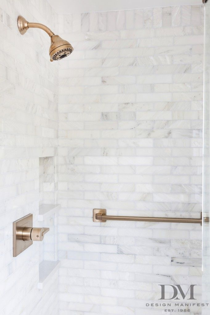 Master Shower With Marble Subway Tile And Brushed Bronze Fixtures - Brushed bronze bathroom hardware