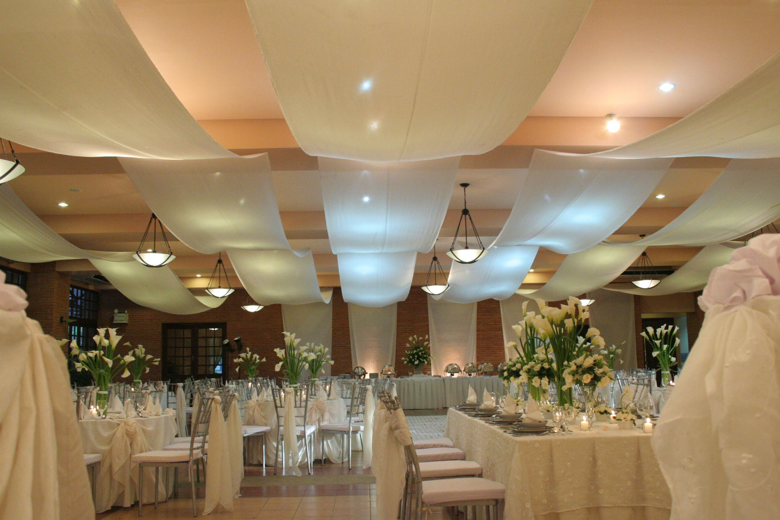 events on ceiling hang chandelier white walkway draping for decor trees aisle in pin silver how navy drapes blue with top pillars hanging to an