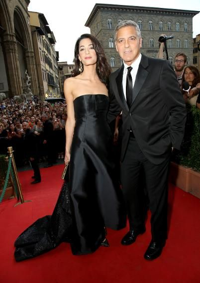 Amal Alamuddin and George Clooney attended the Celebrity Fight Night gala In Italy benefitting The Andrea Bocelli Foundation and The Muhammad Ali Parkinson Center and matched in black Dolce & Gabbana looks.
