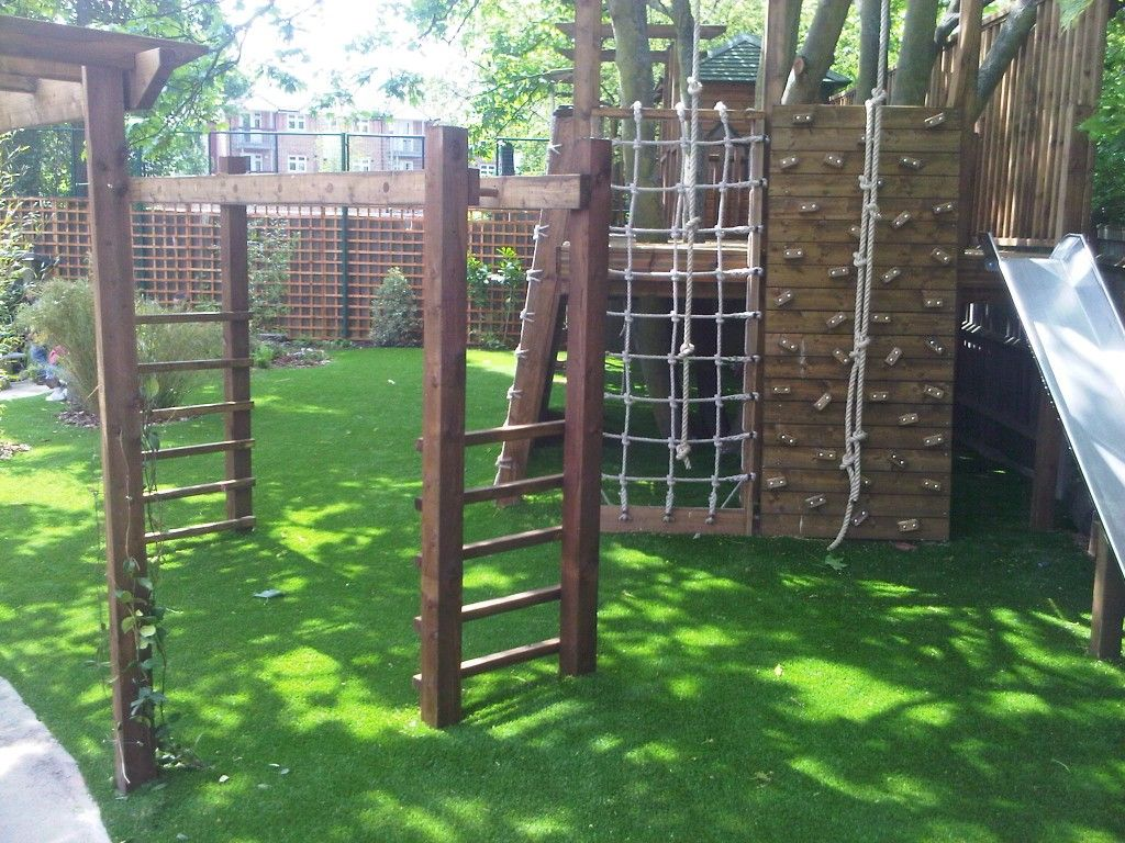 Wooden climbing frame with artificial grass playground ...