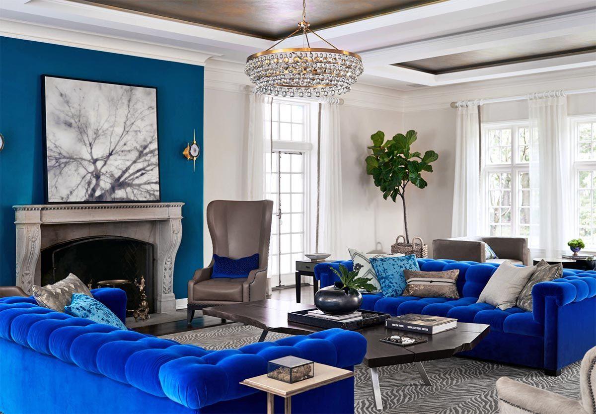 Gorgeous Cobalt Blue And White Living Room Decor With Cobalt Blue Velvet Tufted Sofas Br Blue Living Room Decor Blue Sofas Living Room White Living Room Decor