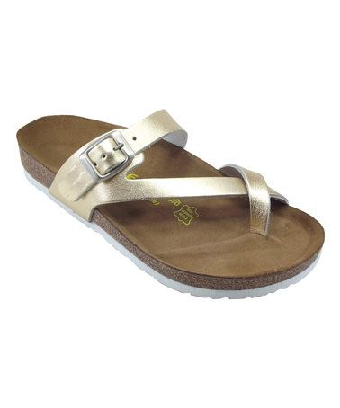 43cee82b10567 Loving this Gold Asymmetrical Leather Thong Sandal - Women on  zulily!   zulilyfinds