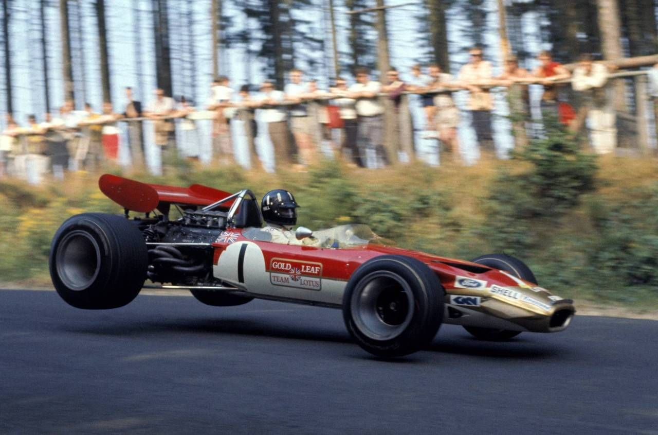 Graham Hill behind the wheel of the legendary Lotus 49B, possibly taken over the jump at the start of Pflantzgarten at the 1969 German Grand Prix.