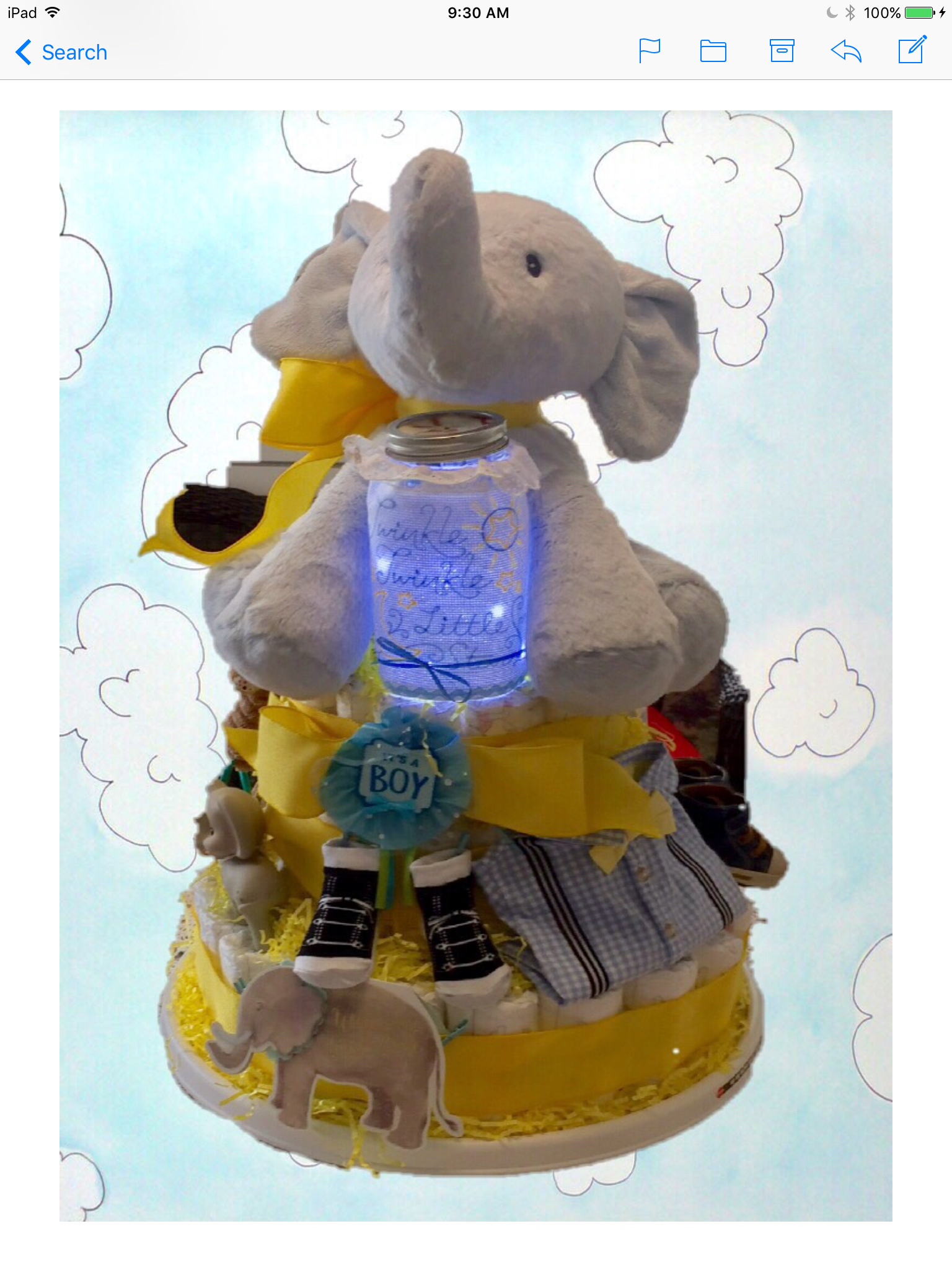 My very first diaper cake that I made For my Granddaughters Baby Shower
