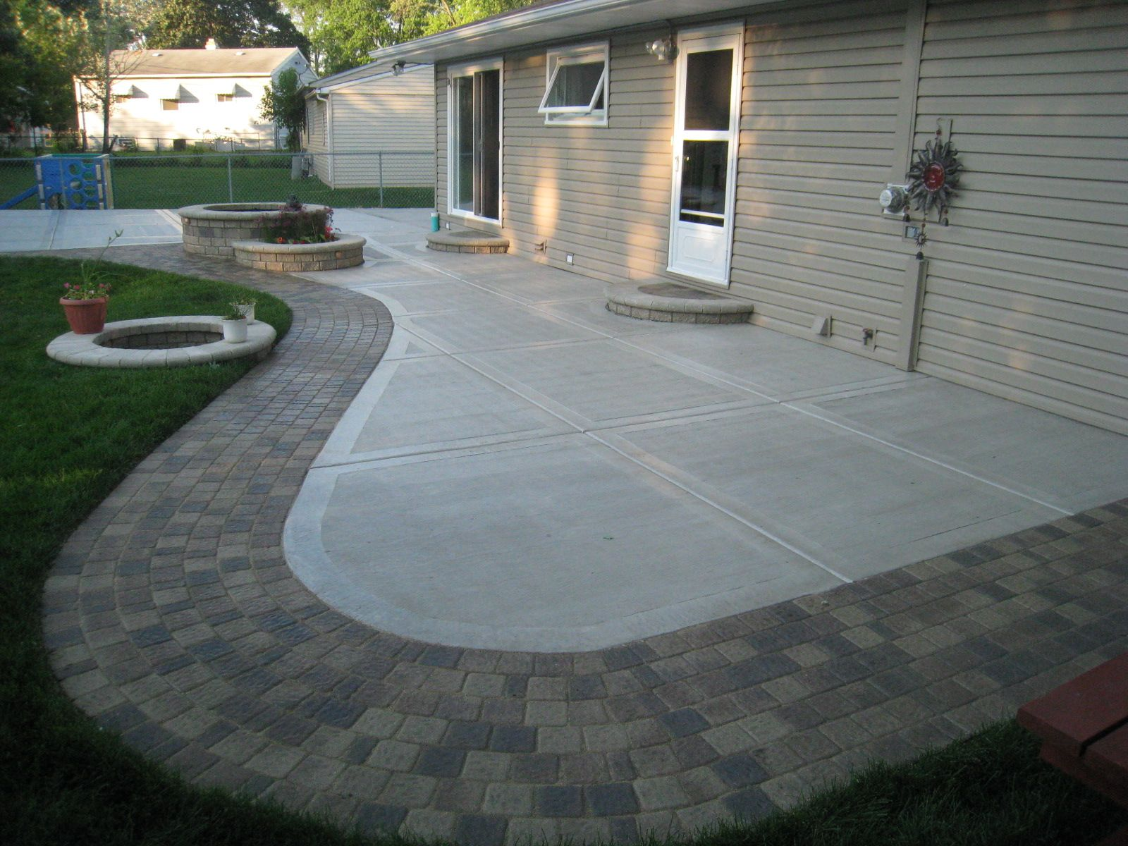 Back Yard Concrete Patio Ideas Concrete Patio California finish and Unilock  Old Greenwich Sierra.I like the concrete with brick edging.