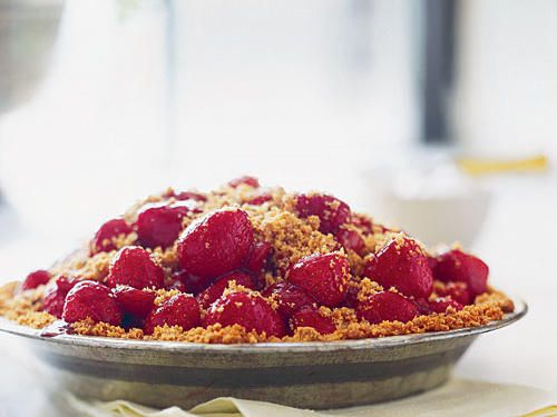 Spring Strawberry Pie | Some slices of pie can chalk up more than 700 calories and 25 grams of fat, but everyone enjoys splurging in a slice every once in a while. Our pie recipes are every bit as flavorful as full-fat, high-calorie varieties, but we've found creative, delicious ways to cut grams of fat and calories without losing a single ounce of flavor.