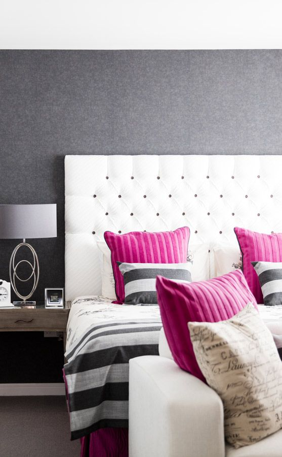 Minimal and delicate bedroom decor! Handcrafted header-board, vintage table, and elegant ottoman bench with amazing white, pink and black tones in a Glasgow family villa!