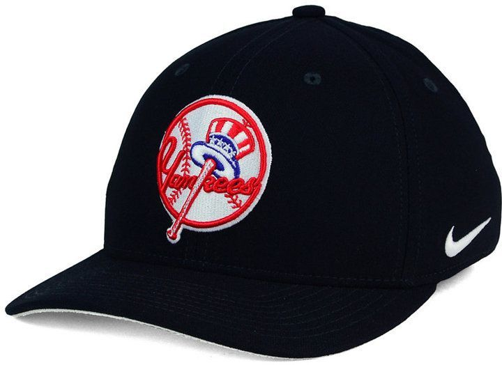 The sleek Nike MLB Ligature Swoosh Flex cap will set you apart from other fans wearing New York Yankees apparel. The baseball hat features a striking team logo and Nike swoosh perfect for a day at the ballpark. Mid crown Structured fit Normal bill Raised embroidered team logo at front Flat embroidered team logo at back Stitched brand logo at left side Stretch fitted Rayon/nylon/spandex Spot clean