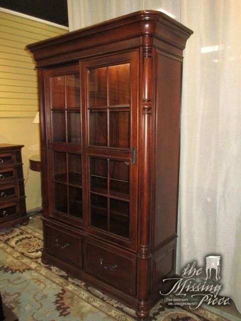 Riverside Sliding Glass Door Bookcase In A Dark Finish There Are