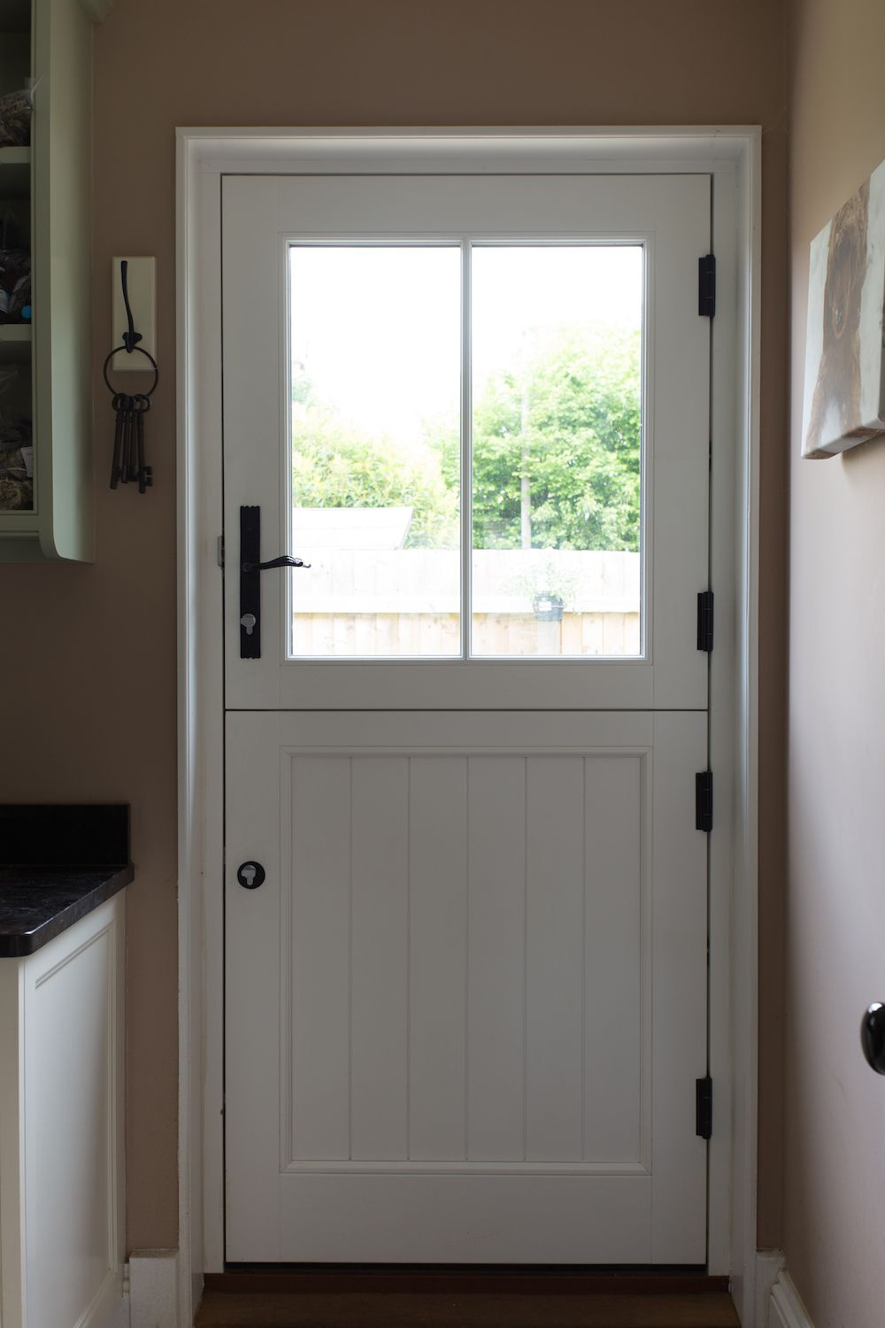 The Inside Of This Timber Stable Door Factory Finished In White The Outside Is Green Rustic Ironmongery By Wood Wi Cottage Door Stable Door External Doors