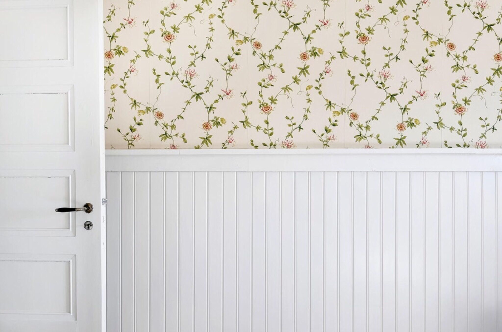 White door wooden panel and a lovely wallpaper with romantic