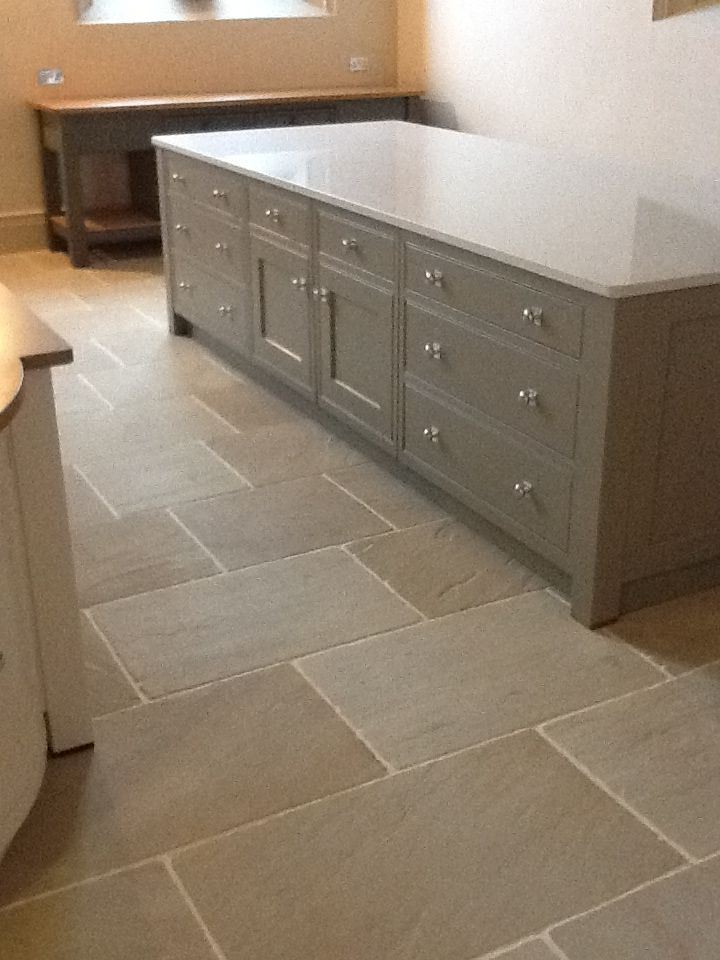 The Worn Ivory Sandstone looks stunning against the sage colour ...