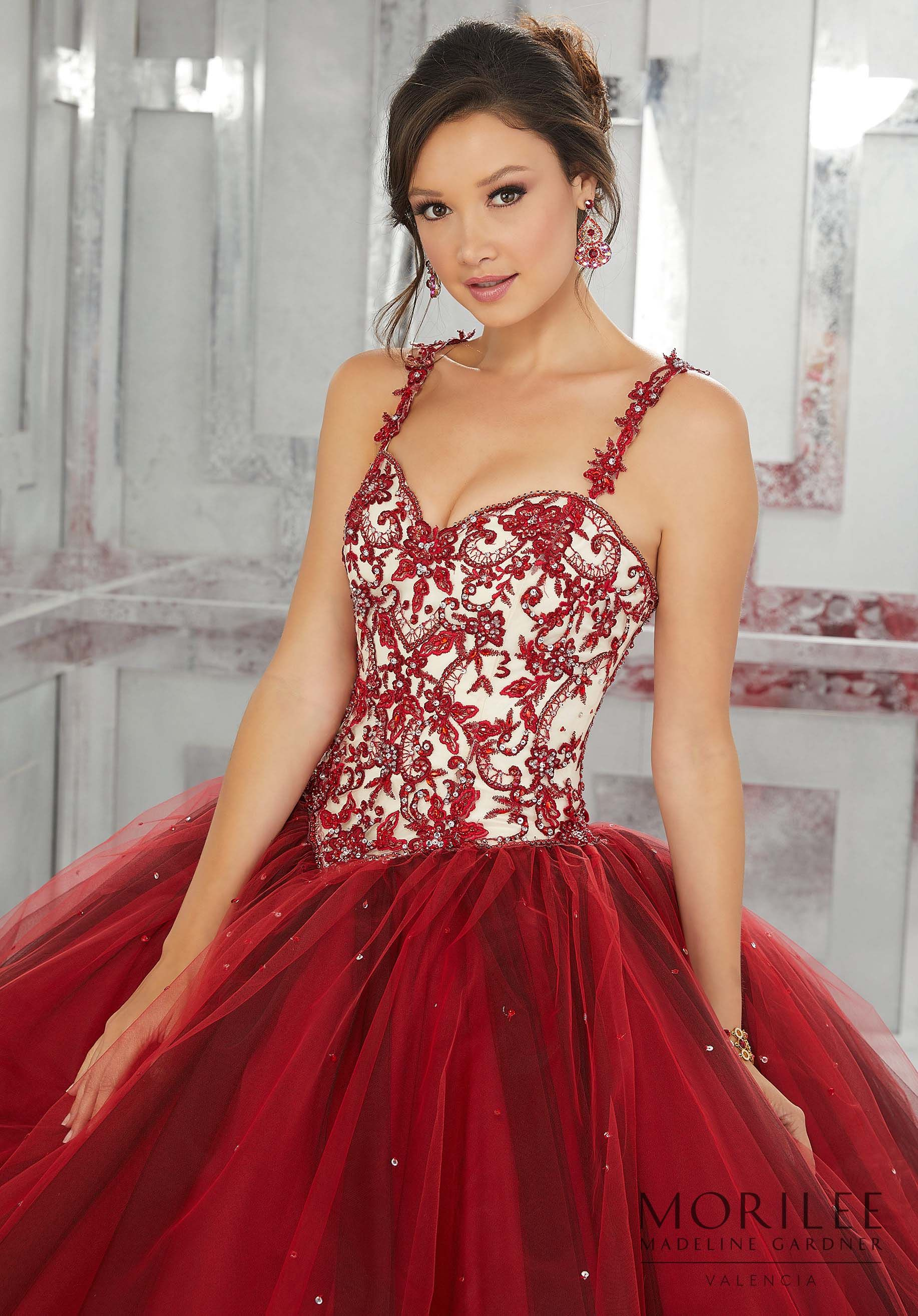 c21d382cd89 Red Beautiful Embroidered Details Take Center Stage on This Tulle  Quinceañera Ball gown. A Sweetheart