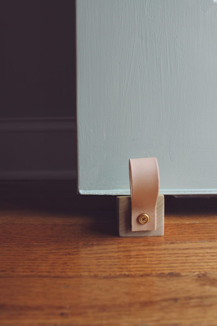 DIY: A Leather-Detailed Wooden Doorstop | Diy doorstop, Wood doors ...
