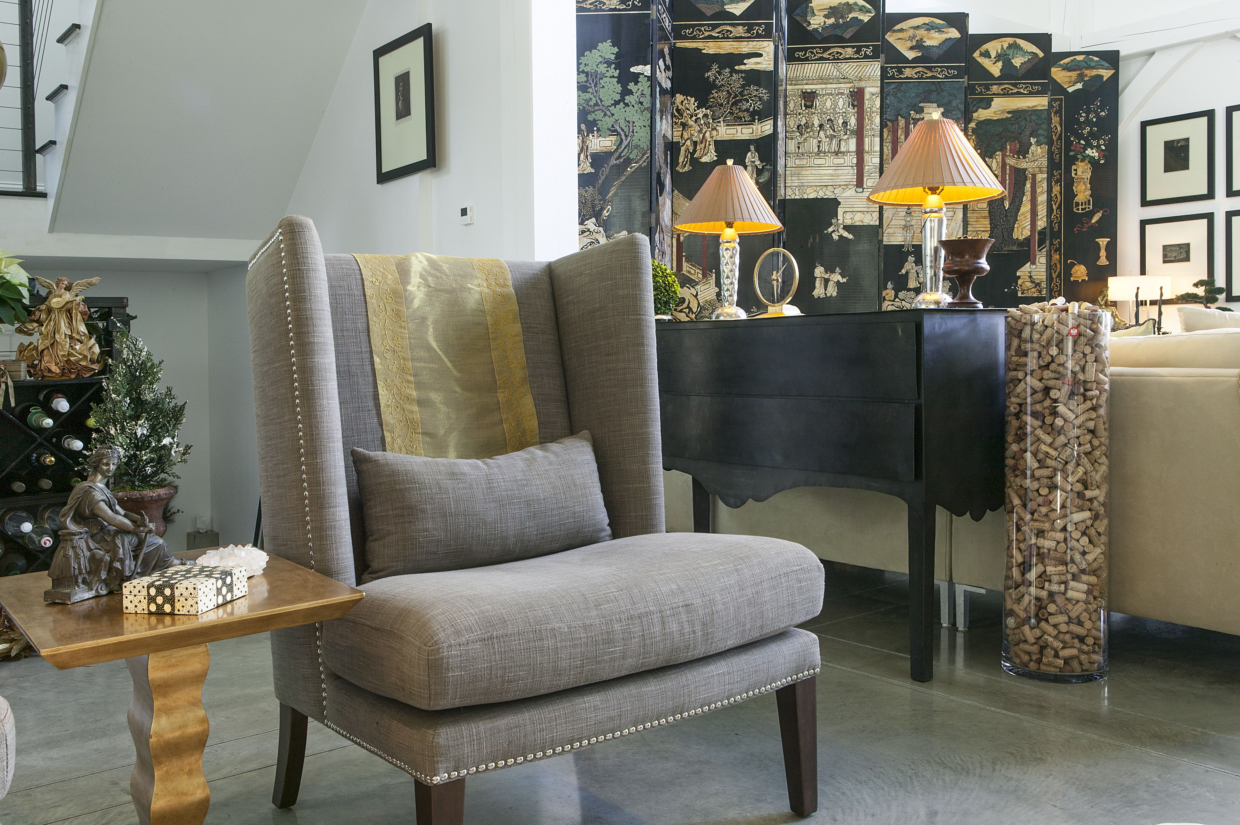 I love my pair of nail head chairs and the zinc sideboard. A large vase holds wine corks - a great conversation starter:)