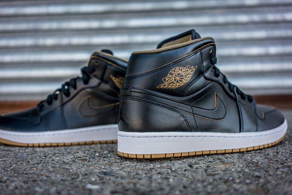 newest 51a58 2fd12 This Black   Gold colorway of the Air Jordan 1 Mid is available now at  select Jordan Brand retailers in full family sizing.