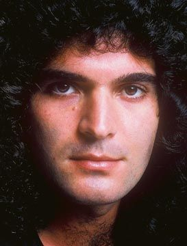 Gino Vanelli. Was so in love with him, almost got ran over by his ...