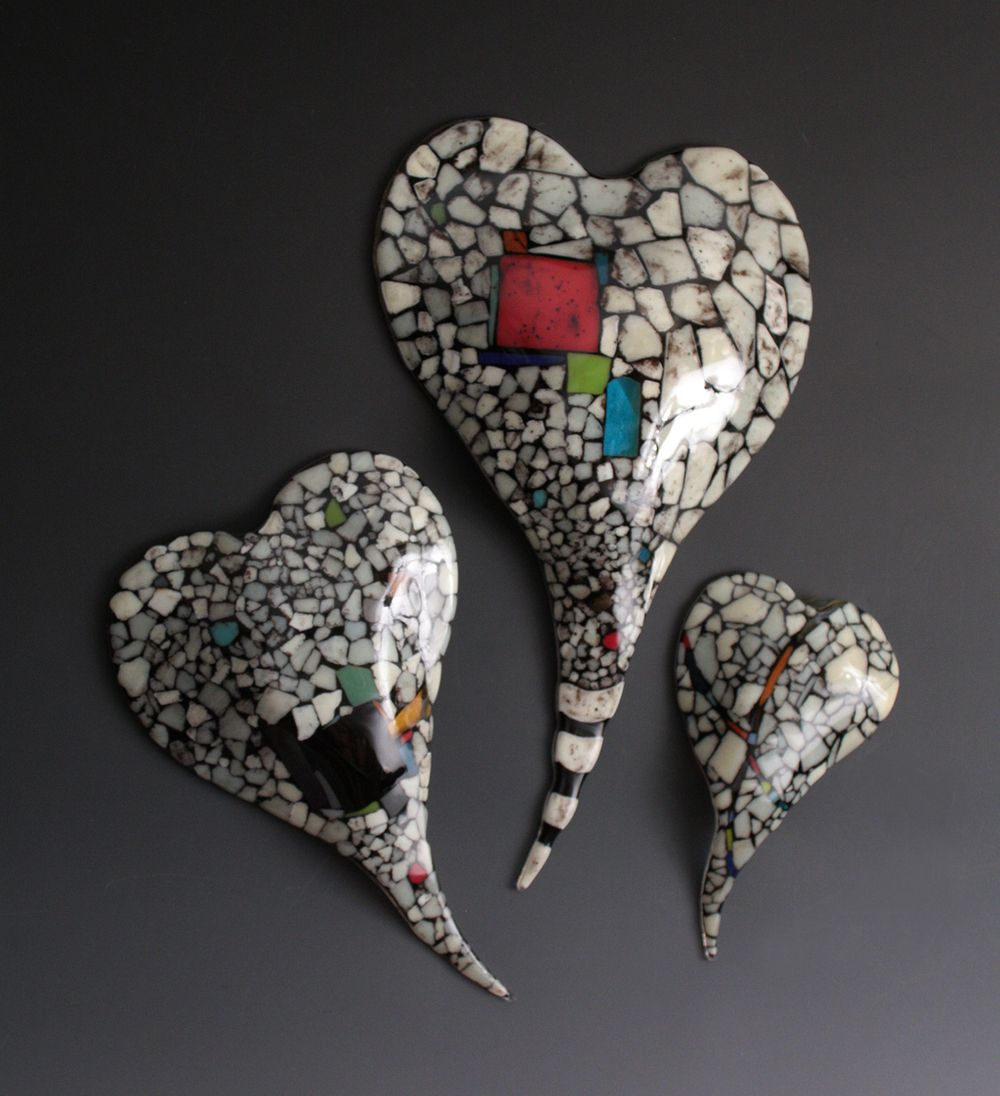 Riverbed Series Fused Glass Wall Hearts - Nina Cambron Studio large chunks of french vanilla, colored and black glass frit to create a rich landscape of glass which is then fired and slumped into its final heart shape over molds made by the artist.