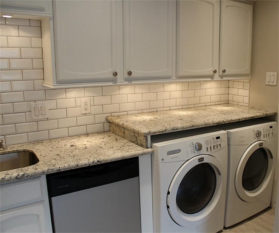 Workspace With Extended Granite Countertops Over Washer And Dryer