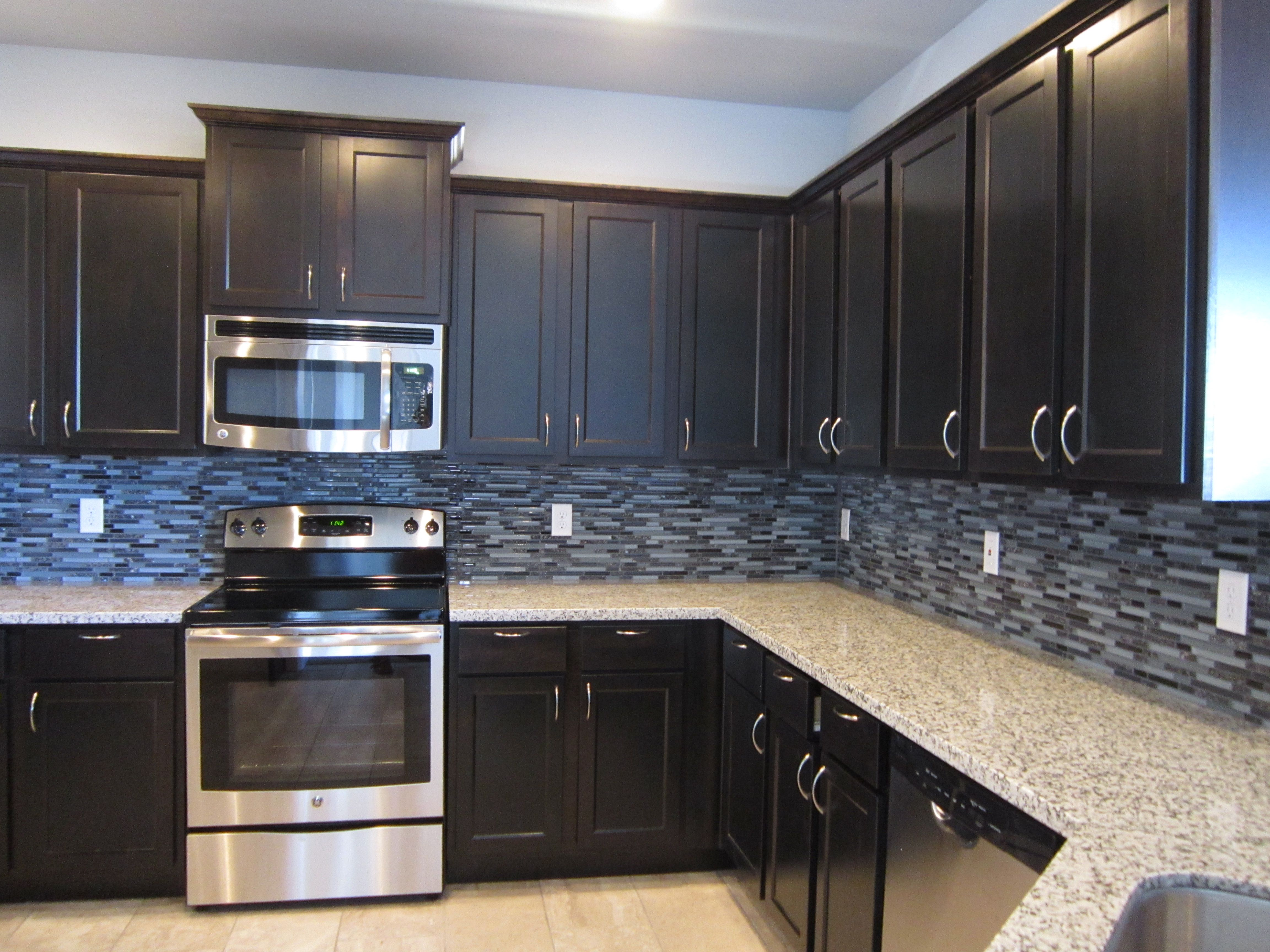 Brown kitchen cabinets with new venetian gold granite countertop ...