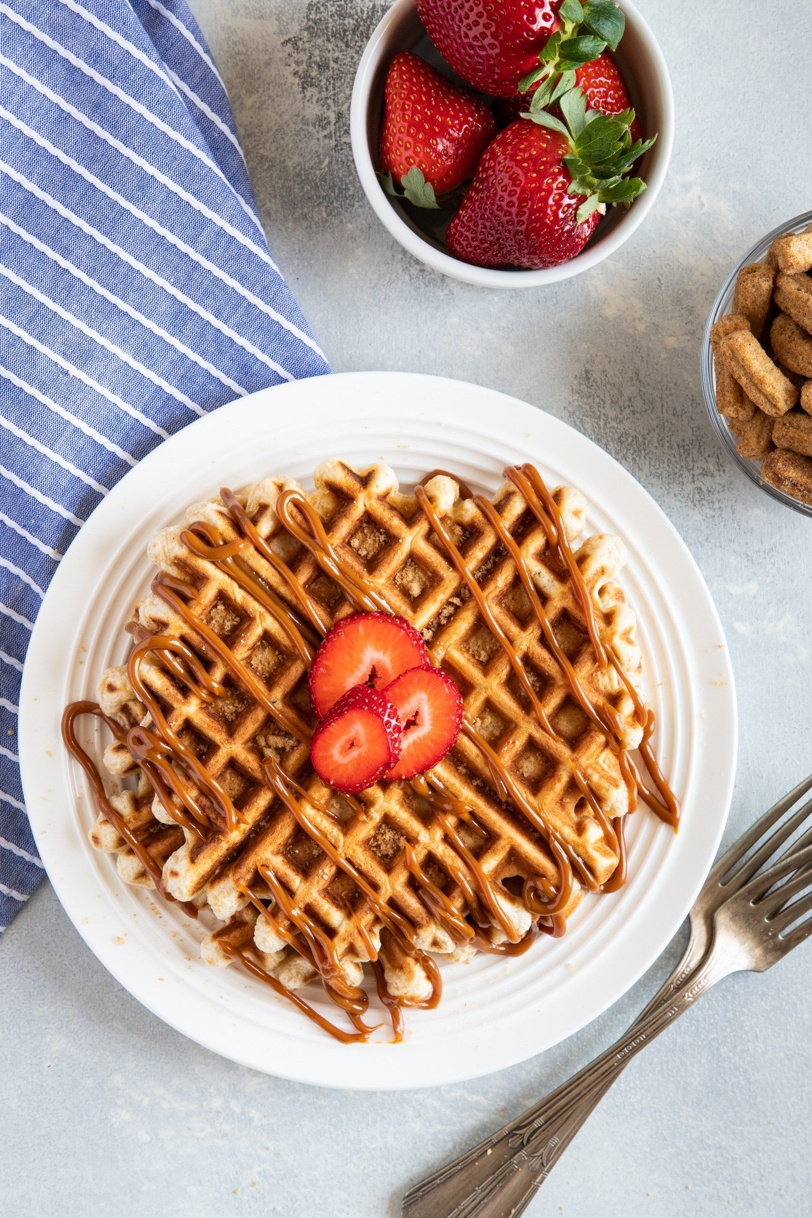 Cinnamon Toast Crunch Churros Waffles with Dulce de Leche #cinnamontoastcrunch With cereal pieces mixed right into the waffle batter, this Cinnamon Toast Crunch Churros Waffles with Dulce de Leche recipe is a playful twist on the classic waffle for a fun and delicious breakfast.  #ad #smartlittlecookie #Churros #Waffles #breakfastrecipes #dulcedeleche #cinnamontoastcrunch Cinnamon Toast Crunch Churros Waffles with Dulce de Leche #cinnamontoastcrunch With cereal pieces mixed right into the waffle #cinnamontoastcrunch