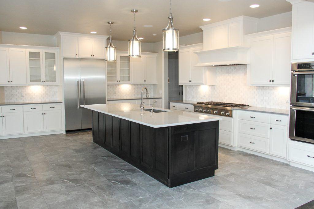 Muted Grey Tile Kitchen Floor With White Tile Backsplash Grey