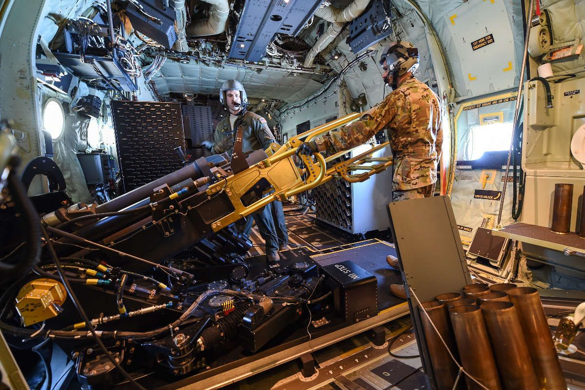 AC-130 gunner   Red barrel of the 105-mm Howitzer visible on an AC ...