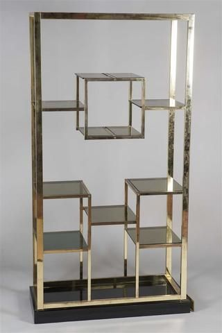 Etagère en métal doré et chromé de section carré , travail français