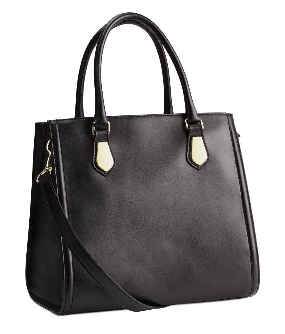 Add extra polish with a black premium-quality leather handbag ...