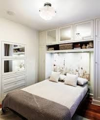 Storage Above Bed Storage Ideas For Small Bedrooms With Cabinets And Open Shelf Over Bed And Built Small Bedroom Storage Small Master Bedroom Bedroom Interior