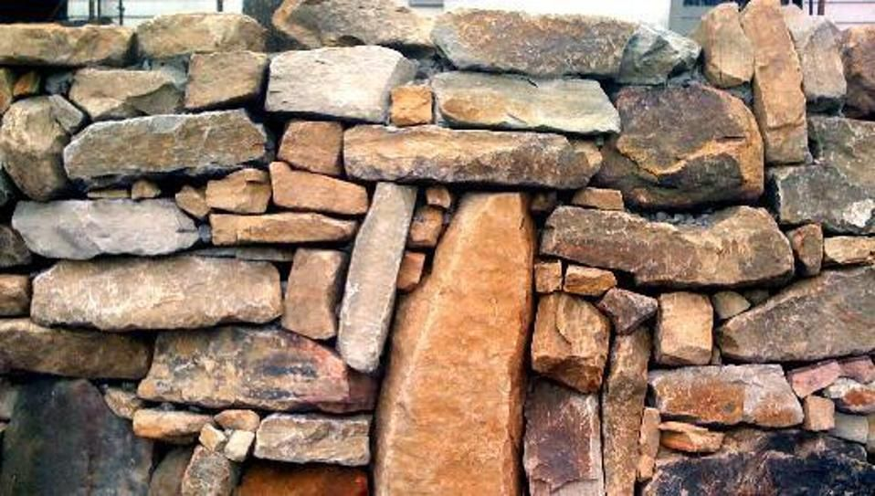 stack stone wall with masonry cap