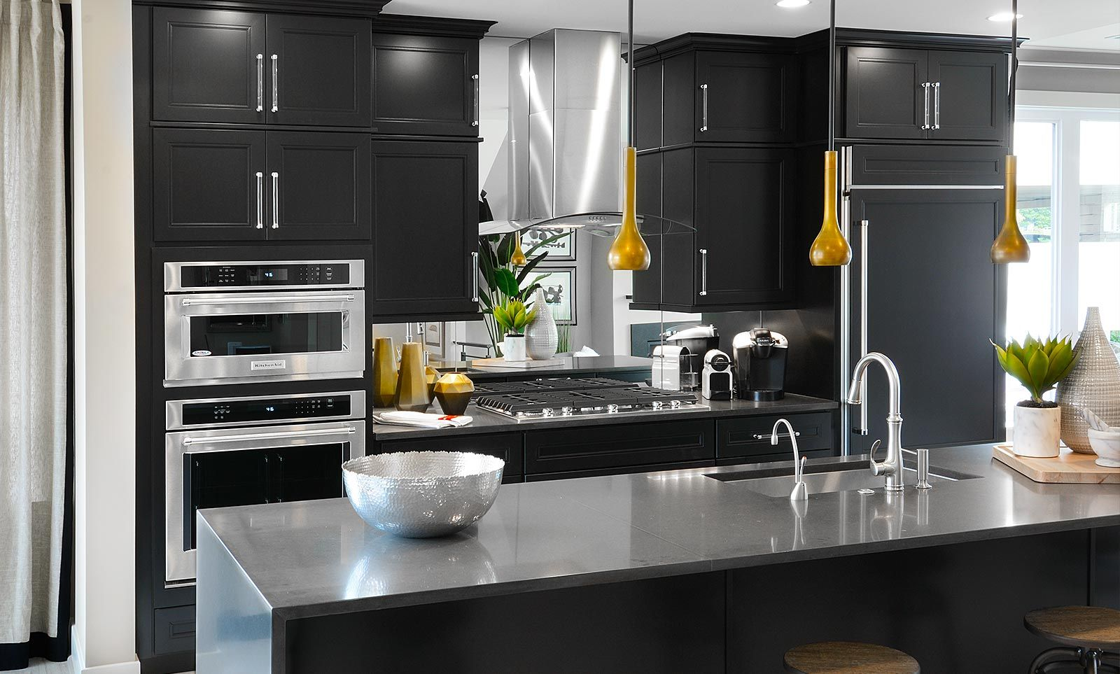 This Contemporary Kitchen With Sleek Black Cabinets And Dark Gray Quartz Countertops Can Be Found Gray Quartz Countertops Contemporary Kitchen Luxury Townhomes
