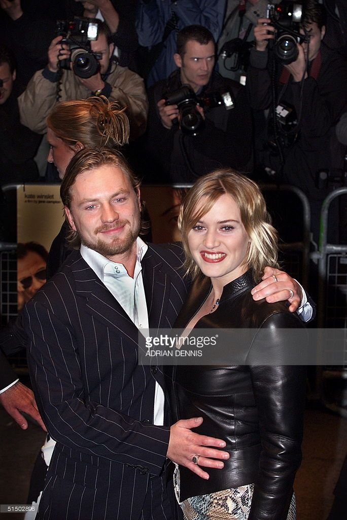 Kate Winslet poses for photographers with her husband film director Jim Threapleton at the premiere of 'Holy Smoke' at the Odeon West End in London late 21 March 2000. Winslet who is expecting her first baby in september stars with US actor Harvey Keitel in New Zealander Jane Campion's new movie.