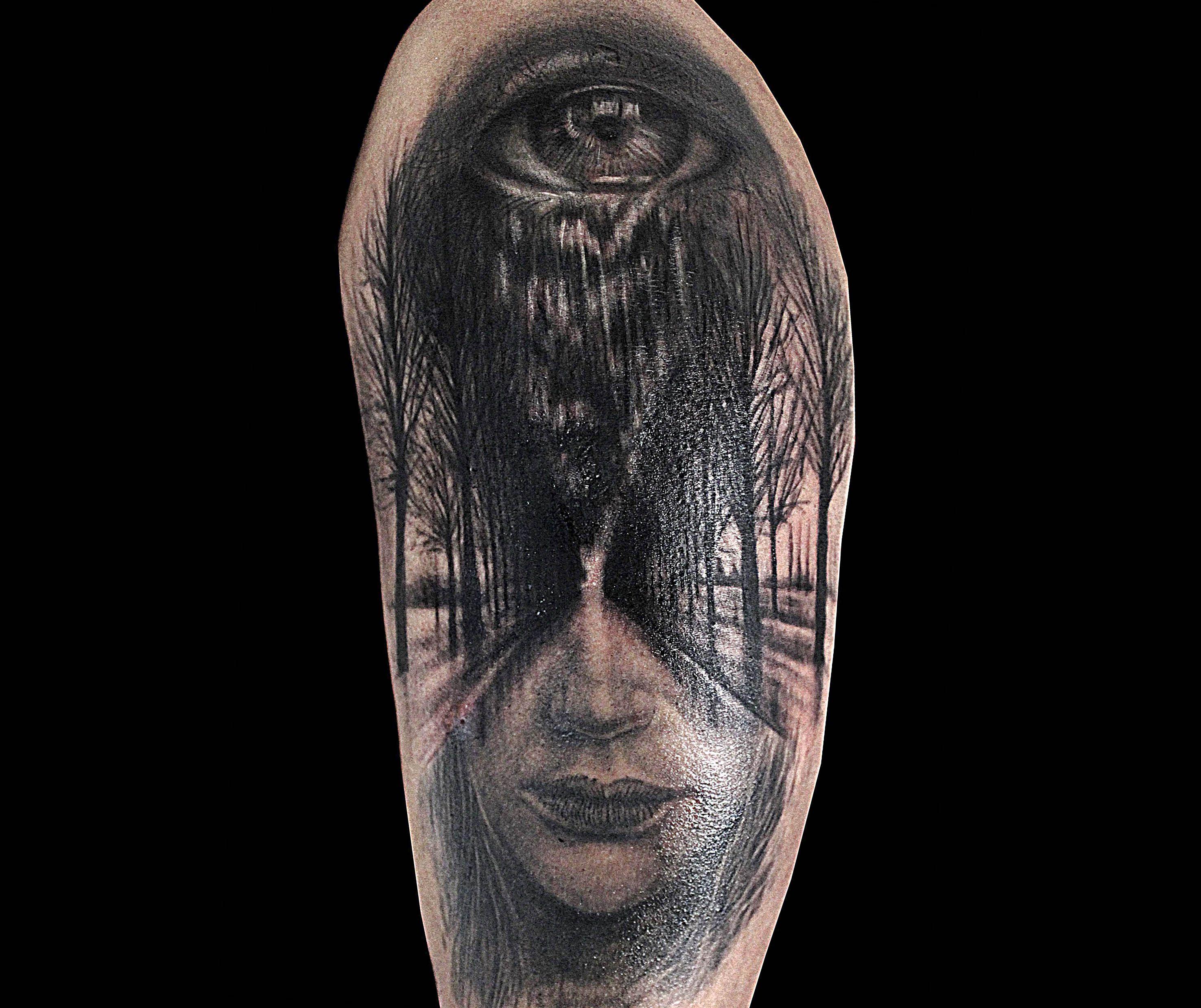 Eyes, trees, half face tattoo