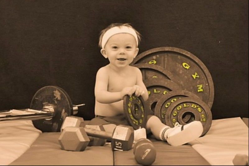 Gold's Gym poster child? My little weight lifter 1 year old