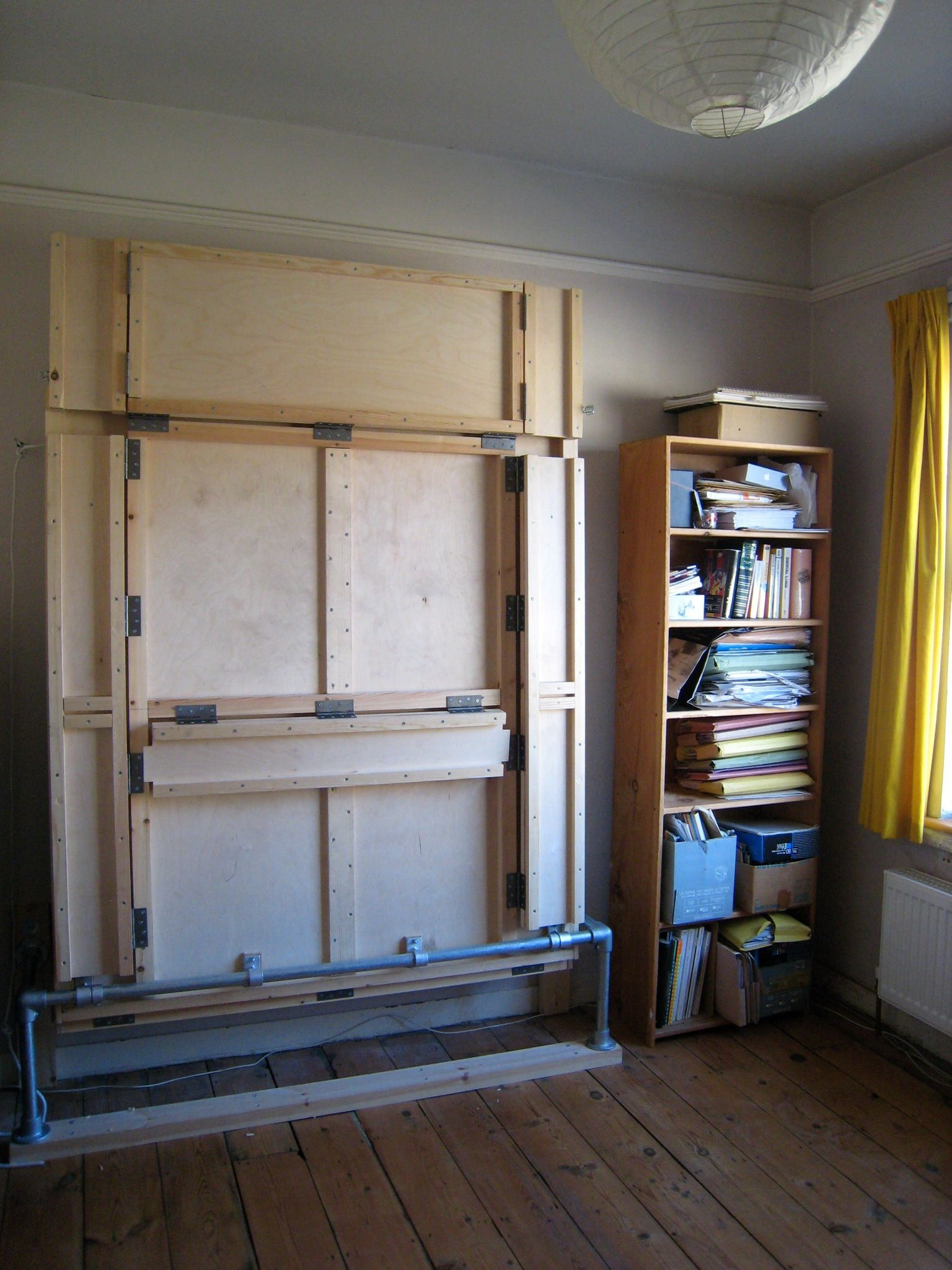 The wallbed in its folded up positionfolded position