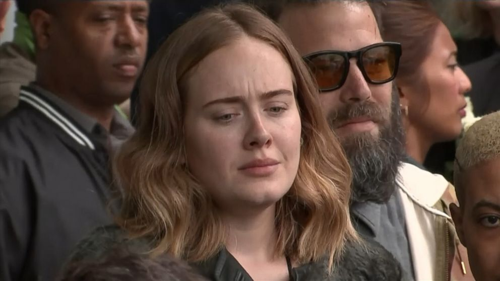 Adele joins mourners singing 'Lean on Me,' marking 1 year since Grenfell Tower fire killed 72 - ABC News