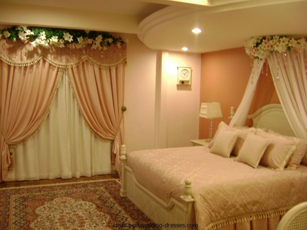 Wedding room decoration ideas  Bed decoration with flower and candles easstweddingdresses