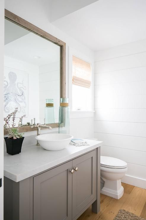 Lovely Gray And White Powder Room Features A Reclaimed Wood Vanity Mirror Hung Above Bath Accented With Polished Nickel