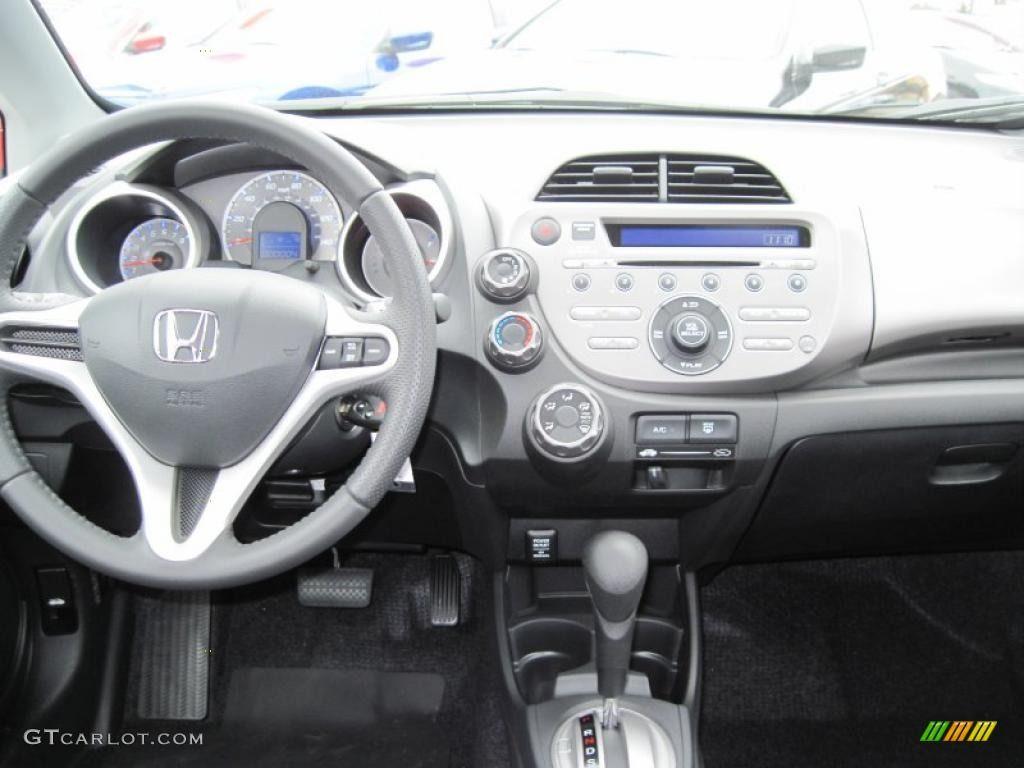 2010 Honda Fit Sport   Orange Revolution Metallic Color / Sport Black  Interior